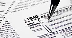 Photo: IRS 1040 Tax Form Being Filled Out by Ken Teegardin courtesy of http://www.seniorliving.org/
