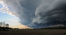 Photo: Large cloud approaches over farm fields.