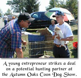 A young entrepreneur strikes a deal on a potential hunting partner at the Autumn Oak Coon Dog Show.
