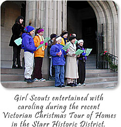 Girl Scouts entertained with caroling during the recent Victorian Christmas Tour of Homes in the Starr Historic District.