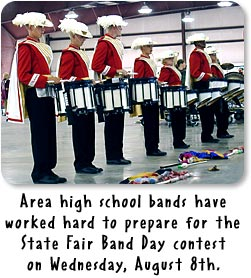 Drum line for the Richmond High School Marching Band prepares for Band Day at the State Fair.
