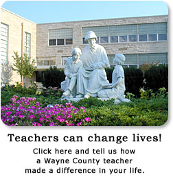 Teacher/Student sculpture in front of Seaton West school.  Click to tell how a Wayne County teacher made a difference in your life!