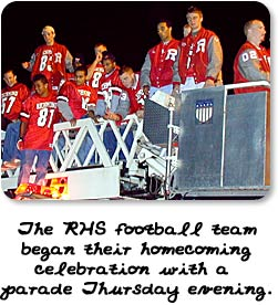 The RHS football team began their homecoming celebration with a parade ride on a firetruck.