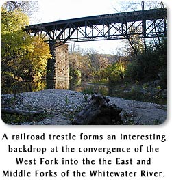 A railroad trestle forms an interesting backdrop at the convergence of the West Fork into the East and Middle Forks of the Whitewater River.