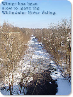 Winter has been slow to leave the Whitewater River Valley.  Photo of frozen Whitewater River, looking north from the U.S. 40 Bridge.