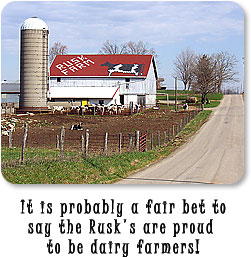 It is probably a fair bet to say the Rusk's are proud to be dairy farmers! (Photo of dairy barn with cow on roof shingles.)