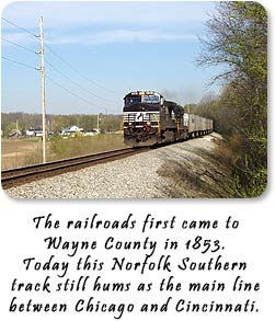 "Photo of train heading east from Hagerstown.  ""The railroads first came to Wayne County in 1853.  Today this Norfolk Southern track still hums as the main line between Chicago and Cincinnati."
