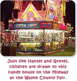 Just like Hansel and Gretel, children are drawn to this candy house on the Midway at the Wayne County Fair.