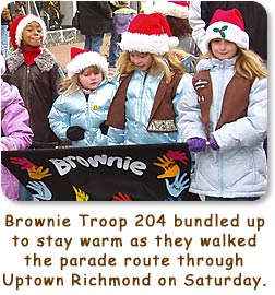 Brownie Troop 204 bundled up to stay warm as they walked the parade route through Uptown Richmond on Saturday.