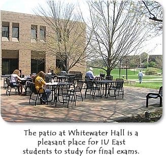 The patio at Whitewater Hall is a pleasant place for IU East students to study for final exams.