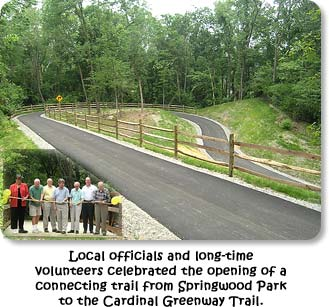 Local offiicals and long-time volunteers celebrated the opening of a connecting trail from Springwood Park to the Cardinal Greenway Trail.