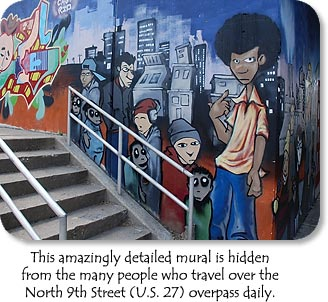 This amazingly detailed mural is hidden from the many people who travel over the North 9th Street (U.S. 27) overpass daily.