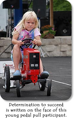 Determination to succeed is written on the face of this young pedal pull participant.