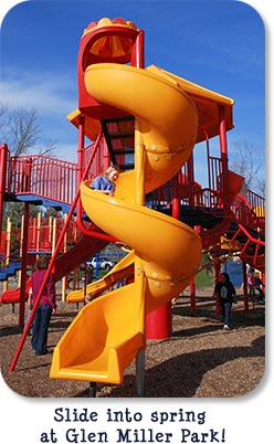 Slide into spring at Glen Miller Park! (Yellow curvy slide in front of red playground equipment at Glen Miller Park.)