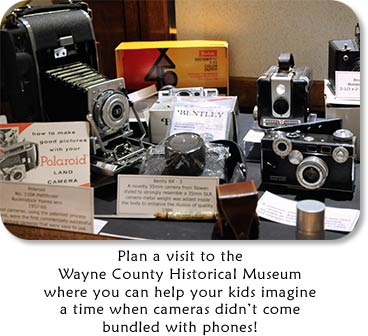 Image: Camera Display  Text: Plan a visit to the Wayne County Historical Museum where you can help your kids imagine a time when cameras didn't come bundled with phones!