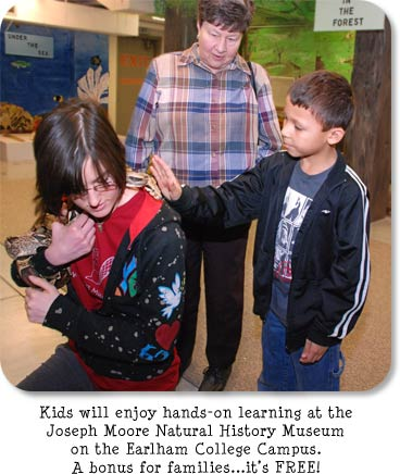Photo: Boy petting snake. Title: Kids will enjoy hands-on learning at the Joseph Moore Natural History Museum on the Earlham College Campus.  A bonus for families...it's FREE!