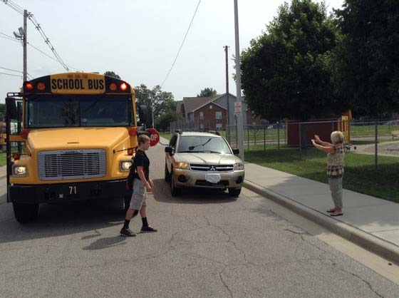 Supplied Photo: Student crossing street in front of school bus.