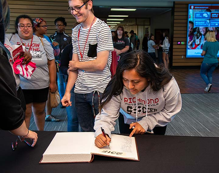 Supplied Photo: Freshman students sign the class book during the First Year Convocation held August 17. The ceremony is the kickoff to new student's academic experience at IU East.
