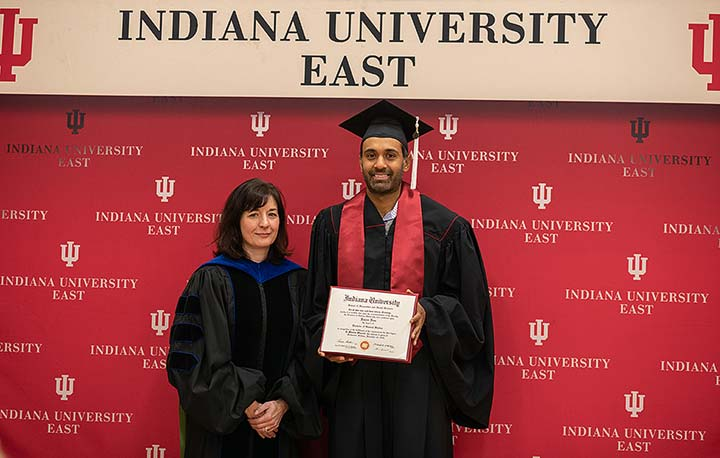 Supplied Photo: Michelle Malott, executive vice chancellor for Academic Affairs, presents Rajeev Ram with his Bachelor of General Studies degree.