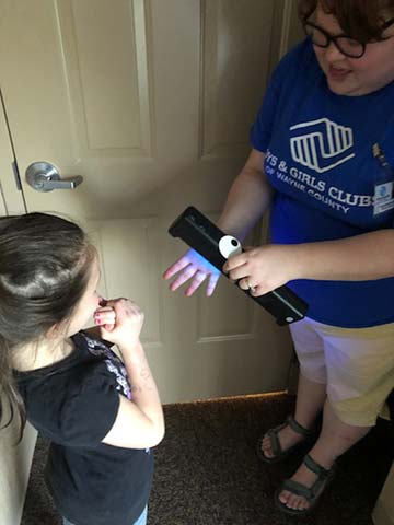 Supplied Photo: The Boys and Girls Club of Wayne County has used the Glitter Bug units to educate and improve children's understanding of handwashing. The unit is provided by the IU East School of Business and Economics.