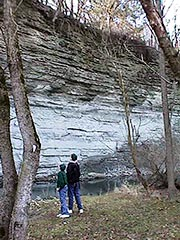 Photo: Boys Look at Limestone Cliff
