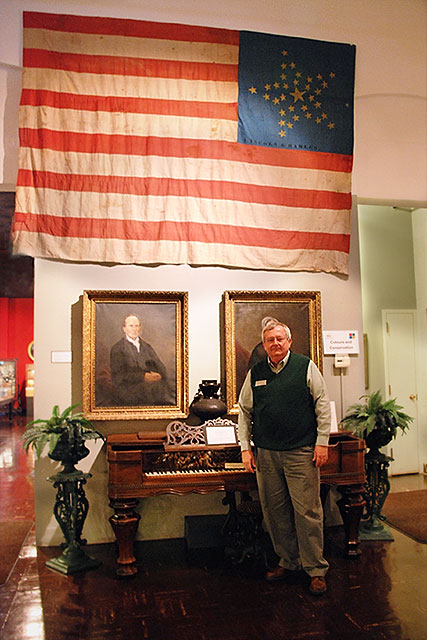 Museum Director, Jim Harlan, with the Lincoln-Hamlin Banner